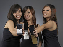 Asian Woman showing their Mobile Phones happily stock photography