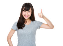 Asian woman showing thumb up Stock Photo