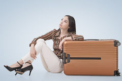 Asian woman sit on ground with a luggage Royalty Free Stock Images