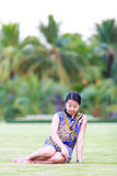 Asian woman sit on ground in park Stock Photography