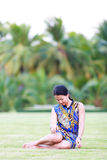 Asian woman sit on ground in park Royalty Free Stock Photo