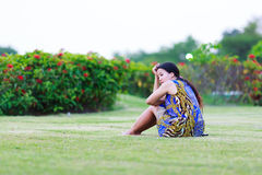 Asian woman sit on ground in park Royalty Free Stock Photography