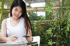 Asian woman sit at outdoor cafe. young female adult with natural Royalty Free Stock Photo