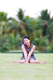 Asian woman sit and smile in park Stock Photography