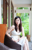 Asian woman sitting in chair Royalty Free Stock Photo