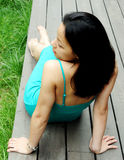 Asian woman sitting on a deck Royalty Free Stock Photography