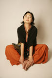 Asian woman sitting down Stock Image