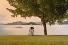 Asian woman sitting on the ground stock images