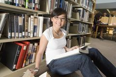 Asian Woman Sitting In Library Stock Photos