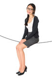 Asian woman sitting on a rope Stock Image