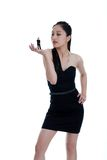 Asian woman sizing up her date. Isolated Asian woman sizing up her date on a white background Royalty Free Stock Photos