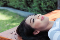 Asian woman sleep on a bench. Royalty Free Stock Photography