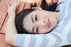 Asian woman sleep on a bench. Stock Photo