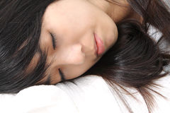 Asian woman sleeping. On bed Royalty Free Stock Images