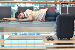 Asian woman sleeping at airport Stock Images