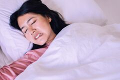 Free Asian Woman Sleeping And Grinding Teeth In Bedroom,Female Tiredness And Stress Royalty Free Stock Image - 176754086