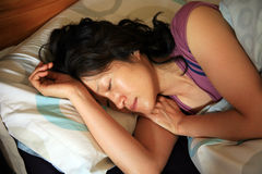 Asian woman sleeping in bed Stock Image