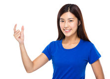 Asian woman with small thing hold on finger Royalty Free Stock Photo