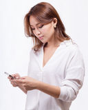 Asian woman with smart phone texting stock images