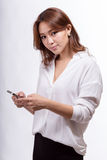Asian woman with smart phone texting stock photography