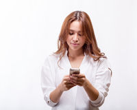 Asian woman with smart phone texting royalty free stock images