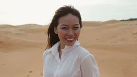 Asian woman smile outdoor desert wind blowing hair stock footage