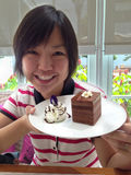 Asian woman smile and show chocolate cake Royalty Free Stock Image