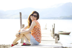 Asian woman smile at sunlight Stock Photos