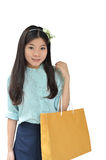 Asian Woman Smiling And Holding Shopping Bag Royalty Free Stock Photo
