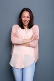Asian woman smiling with arms crossed Royalty Free Stock Photo