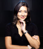 Asian Woman Smiling, Dark Background Stock Photo