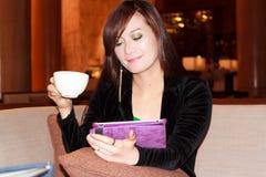 Asian woman smiling. While drinking coffea Stock Photos
