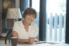 Asian woman smiling face ,education and working at home concept Royalty Free Stock Photo