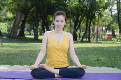 Asian woman smiling faces Are exercising in the park outside the Royalty Free Stock Images