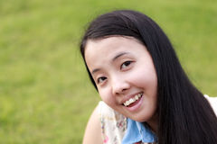 Asian woman smiling with grass Stock Images