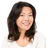 Asian woman smiling happy. Portrait. Beautiful mature middle aged Chinese Asian woman closeup beauty portrait isolated on white background Stock Photography