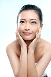 Asian woman smiling looking up Royalty Free Stock Photos