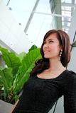 Asian woman smiling in modern building Stock Photos