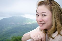 Asian woman smiling natural candid in happy outdoor portrait. In North thailand, PETCHABOON, THAILAND stock images