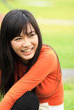 Asian woman smiling in the park Royalty Free Stock Photography