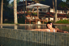 Asian Woman Smiling in a swimming pool Stock Image