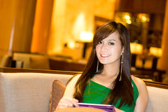 Asian woman smiling. While using ipad Royalty Free Stock Photography