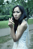 Asian woman with snake Stock Images