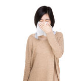 Asian woman sneeze. Isolated on white Stock Photo