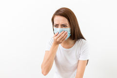 Asian woman sneeze with mask Stock Image