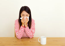 Asian woman sneezing Stock Photo