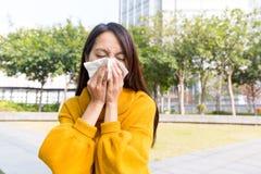 Asian Woman sneezing Royalty Free Stock Image