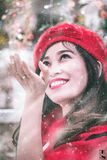Asian woman in snow Royalty Free Stock Image