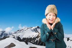 Asian woman on snow mountain Royalty Free Stock Photography