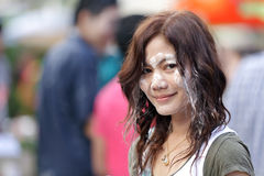 Asian woman in songkran festival. Beautiful asian woman, face covered with wet powder, during Songkran Buddhist new year festival in Thailand Stock Photography